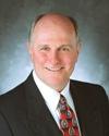 Board Member John H. Cavanaugh