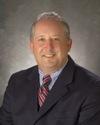 Board Member Carl D. DeYulis
